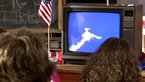 Children watching the Challenger disaster on TV