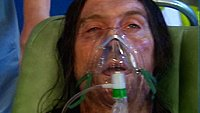 Frank using an oxygen mask