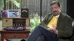 Stephen Fry sits at a desk and films Channel 4's Stephen Fry: Gadget Man
